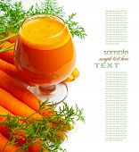 stock photo of carrot  - carrots and carrot juice in a glass - JPG