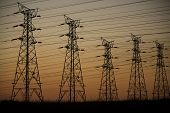 stock photo of power transmission lines  - Electrical transmission power supply lines at dusk - JPG