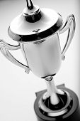pic of trophy  - Silver trophy cup high angle view over a grey background to be awarded to the winner or second placed contestant in a competition or championship - JPG