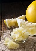 foto of pomelo  - Pieces of a fresh Pomelo Fruit on wooden background - JPG
