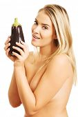 picture of aubergines  - Shirtless smiling woman holding an aubergine - JPG