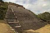 stock photo of mayan  - A Mayan Pyramid with cascading stairs and a temple on top - JPG