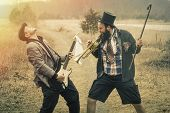 foto of gypsy  - Stylish gypsies play trumpet and electric guitar on a wilderness path - JPG