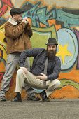 picture of newsboy  - Two snazzy stylish men hang out on a street corner - JPG