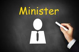 pic of prime-minister  - businessmans hand writing minister on black chalkboard - JPG