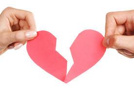 stock photo of broken-heart  - man woman hands holding broken heart on white background - JPG