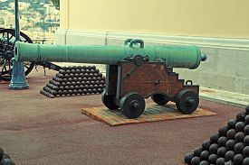 pic of cannon-ball  - Cannon and cannon balls near Royal Palace, official residence of the Prince of Monaco. Vintage toned image.