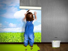picture of overhauling  - Funny child hanging wallpaper doing repairs - JPG