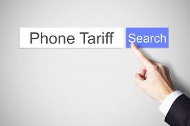 stock photo of tariff  - finger pushing blue web search button phone tariff - JPG