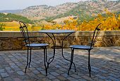 Tables and chairs outside the winery in Napa Valley in Autumn at sunset