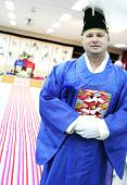 stock photo of hanbok  - Western man prepares to marry his South Korean bride in a traditional ceremony  - JPG