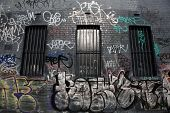 Messy graffiti  painted on a wall.