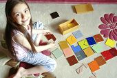 foto of tangram  - Girl plays tangram - JPG