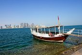 Doha Qatar  - A trip dhow waits for customers
