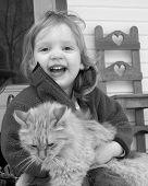 Criança com um gatinho