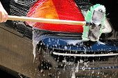 stock photo of car wash  - Shot of the back end of a car being cleaned - JPG