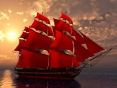 ship in the sea with red sails in sunset