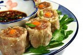 picture of siomai  - close up of steamed pork dumpling with spicy soy dip - JPG