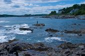 Stiper Fisherman Fishing Rocky Coast, Southern Maine