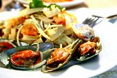 plate of delicious seafood pasta, shallow DOF