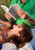 image of nic  - couple reading a book outdoor at sunset - JPG