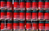 Red oil drums wrapped in plastic on wooden pallets