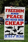 DENVER - AUGUST 26: A conservative demonstrator holds a sign promoting US military power during the