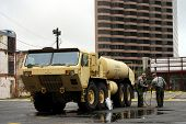 NEW ORLEANS - SEPT 1: National Guardsmen stand next to a fuel tanker after Hurricane Gustav passed t