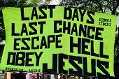 Poster urging people to believe in Jesus and warning about the end of time, held up during a demonst
