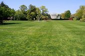 South facade and South lawn of the White House in Washington DC in spring colors, with horizontal copyspace on the fresh green lawn