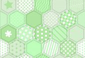 A vector illustration of a patchwork fabric in shades of green