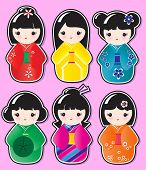 Kokeshi doll stickers in various designs on pink background. Also available in vector format.