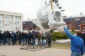 MOSCOW - APRIL 07: Workers ready to unwrap statue of Yuri Gagarin  on April 07, 2011 in Moscow, Russia. Yuri Gagarin is the first Russian cosmonaut.