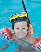 foto of swimming pool family  - photo of an adorable boy learning to swim - JPG