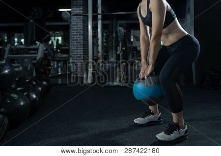 poster of Woman Exercise Workout At Gym Fitness Training Sport With Kettlebells Weight Lifting And Legs Squat