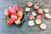 Fresh Red Apples. Harvest Of Apples. Pink Apples On A Wooden Background. Leaves Of Apple. Freshly Ha poster