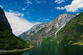 Norway. Water Between Mountain Cliffs With Ships Norwegian Fjords. River Lagoon Norwegian Fjords Stu poster