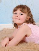 Closeup Of Girl  In Dress Laying On A Furry Brown Rug poster