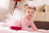 Beautiful Little Baby Girl Wearing Pink Tutu Skirt, Crawling On The Floor, Making Her First Independ poster