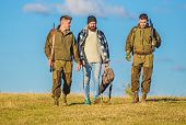 Group Men Hunters Or Gamekeepers Nature Background Blue Sky. Guys Gathered For Hunting. Men Carry Hu poster