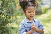 Little Girl Praying. Kid Prays. Gesture Of Faith.hands Folded In Prayer Concept For Faith,spirituali poster