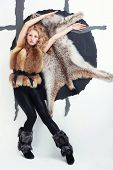 Vogue Style Photo Of Young Girl In A Fur Coat