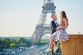 Romantic Couple Near The Eiffel Tower In Paris, France poster