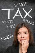 Tax stress worried businesswoman looking scared stressed doing funny anxious facial expression over  poster