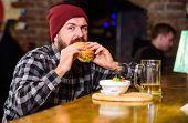 High Calorie Food. Delicious Burger Concept. Enjoy Taste Of Fresh Burger. Hipster Hungry Man Eat Bur poster