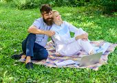 Couple Bearded Man And Blonde Woman Relax Nature While Sit On Green Grass Meadow. Relax And Inspirat poster