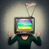 Addicted Young Woman Holding Fists Up And Old Tv Instead Of Head. Television Manipulation And Brainw poster