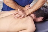 Physiotherapist Giving A Back Massage. Chiropractic, Osteopathy, Manual Therapy, Acupressure poster