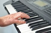 Hand Playing Electronic Keyboard