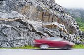 Blurry Car Driving Fast In Norway Mountains. Blurried Vehicle Riding Through Street In Nature. poster